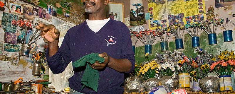 Artists Golden displaying his Tincan flowers
