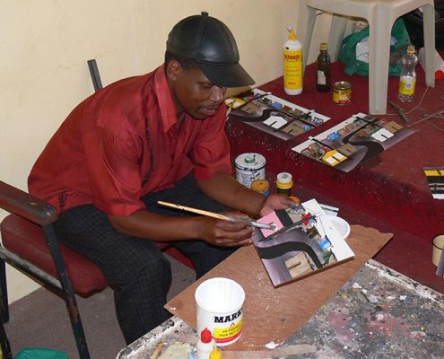 Artist Mgadi making 3d painting out of recycled trash