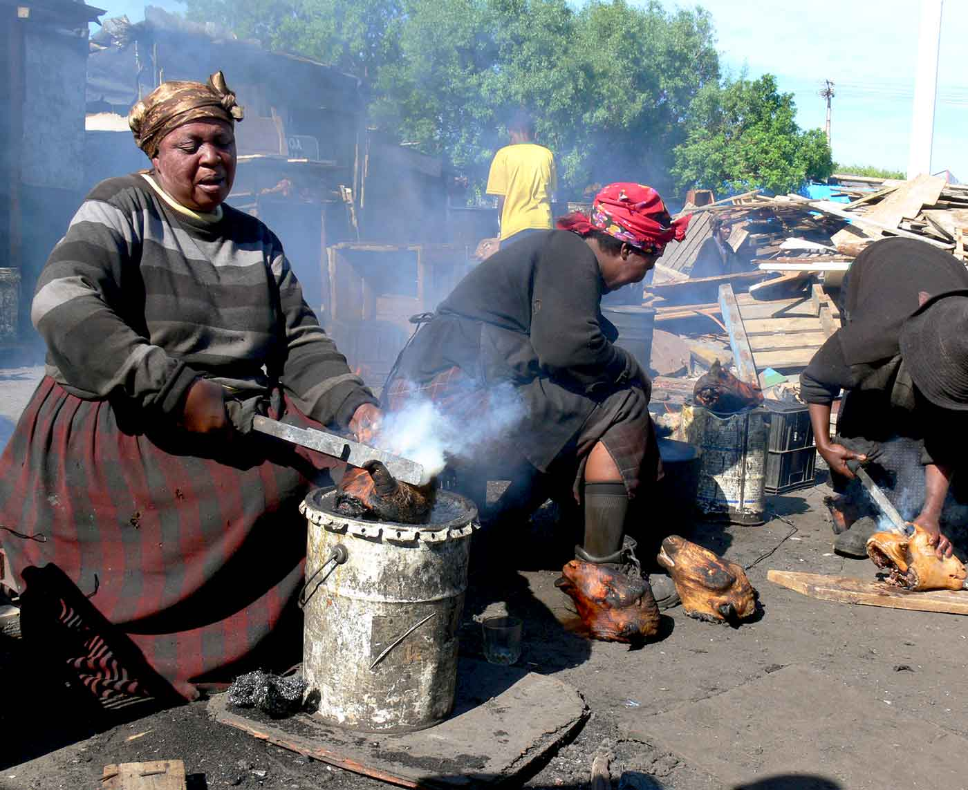 Township women preparing sheep heads